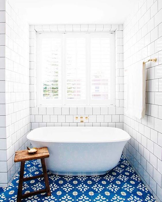 Bright blue bathroom tiles perk up a floor | Girlfriend is Better