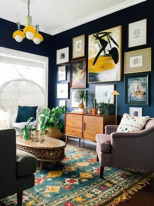 Create a large gallery wall on dark paint to lower intensity in the room | Girlfriend is Better