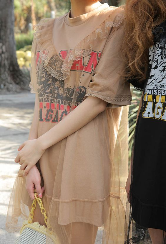 Pair over-sized graphic tees with sheer dresses   Girlfriend is Better