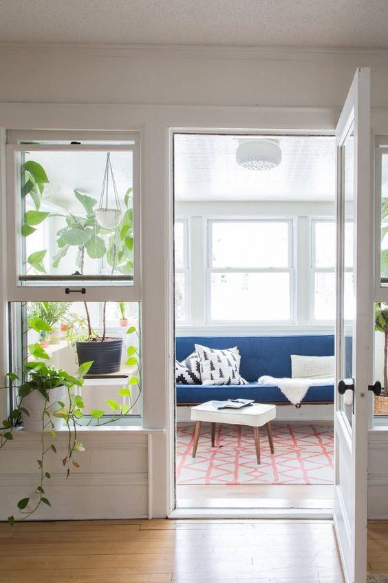 Turn a covered porch into a sunroom | candinavian, Midwestern Cabin mid-century modern | Girlfriend is Better