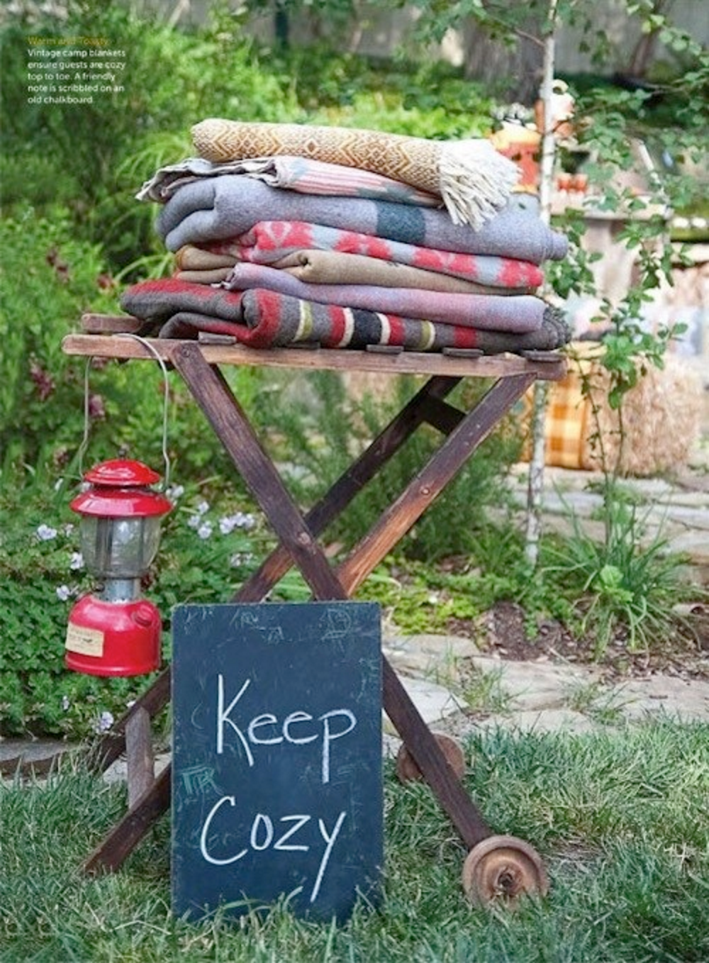 Cozy blankets as patio party decor | Girlfriend is Better