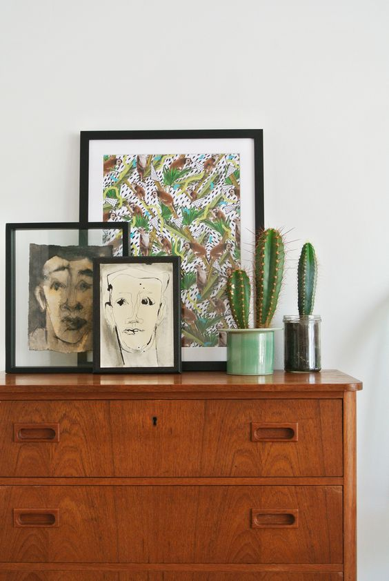 Charcoal portraits of random men on mid-century dresser | Girlfriend is Better