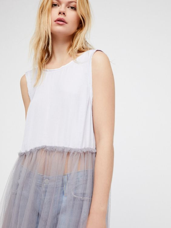 Half-tulle slips layered over skinny jeans | Girlfriend is Better