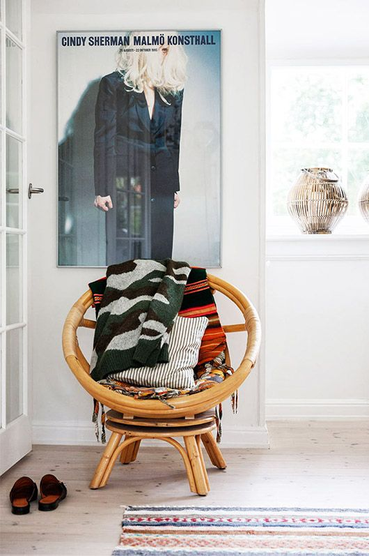 Round bamboo chair in a bright entryway | Girlfriend is Better