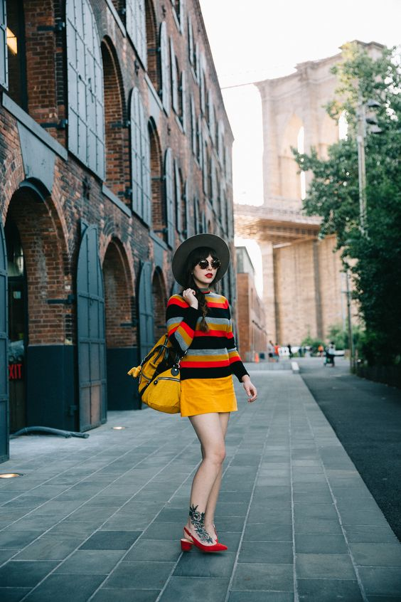 70s inspired yellow corduroy mini skirt and striped sweater | Girlfriend is Better
