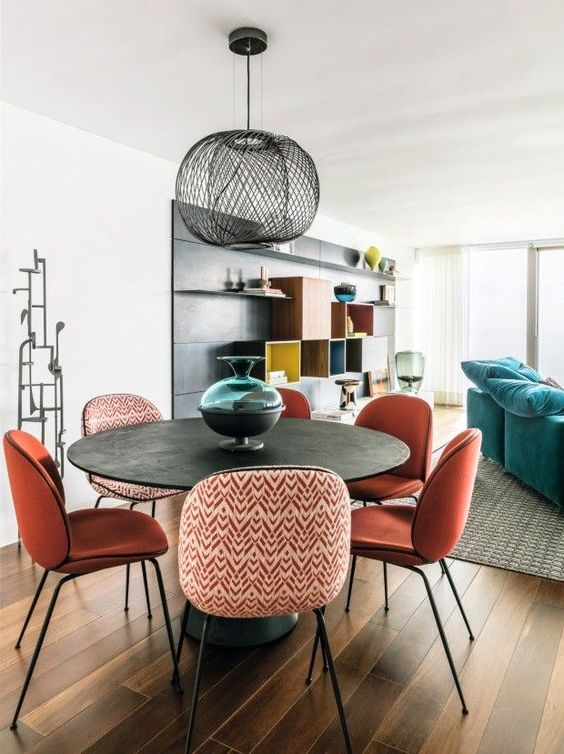 Gemini astrology home decor guide | Bohemian dining room table orange chairs | Girlfriend is Better