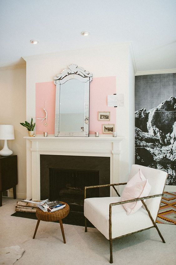 Leo astrology home decor guide | Mid-century modern living room fireplace arm chair mirror pink oversized art photography| Girlfriend is Better