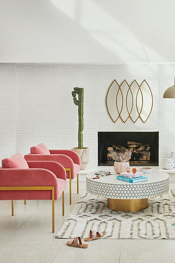 Leo astrology home decor guide   Mid-century modern living room pink armchairs gold accents round table living room   Girlfriend is Better