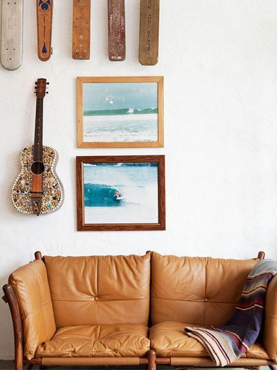 wood element Feng Shui | Bohemian tan leather sofa surf gallery wall frames | Girlfriend is Better