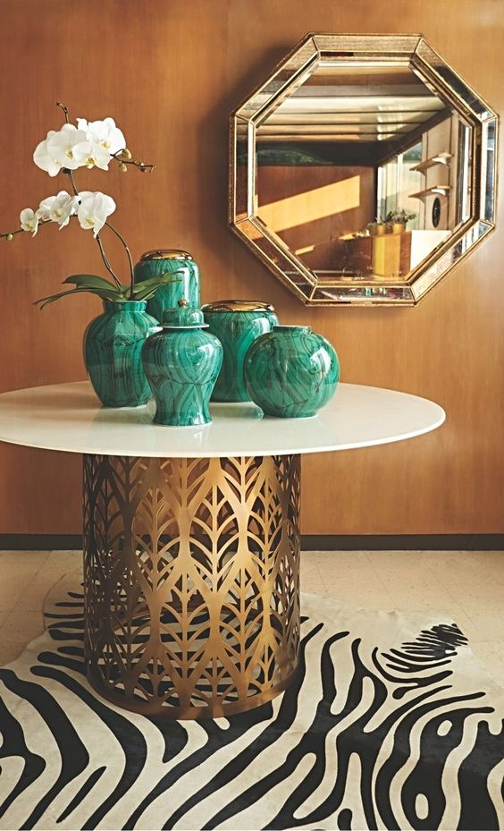 chinoiserie malachite vases | laser-cut brass metal dining table zebra area rug | Girlfriend is Better