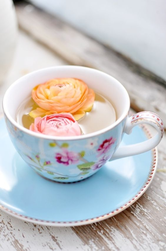 Afternoon Tea | flowers in filled teacup on wood slab | Girlfriend is Better