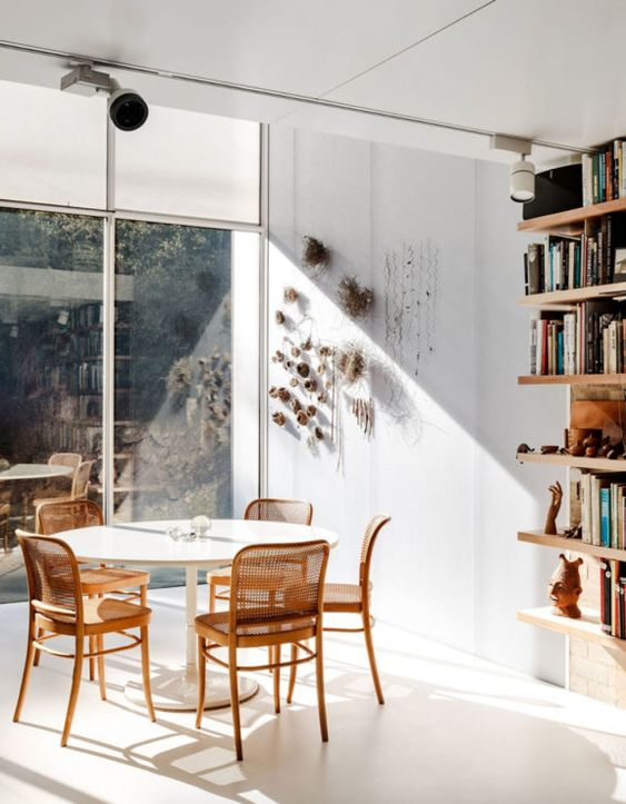 caned chairs   light minimalist seats open shelving dining room   Girlfriend is Better
