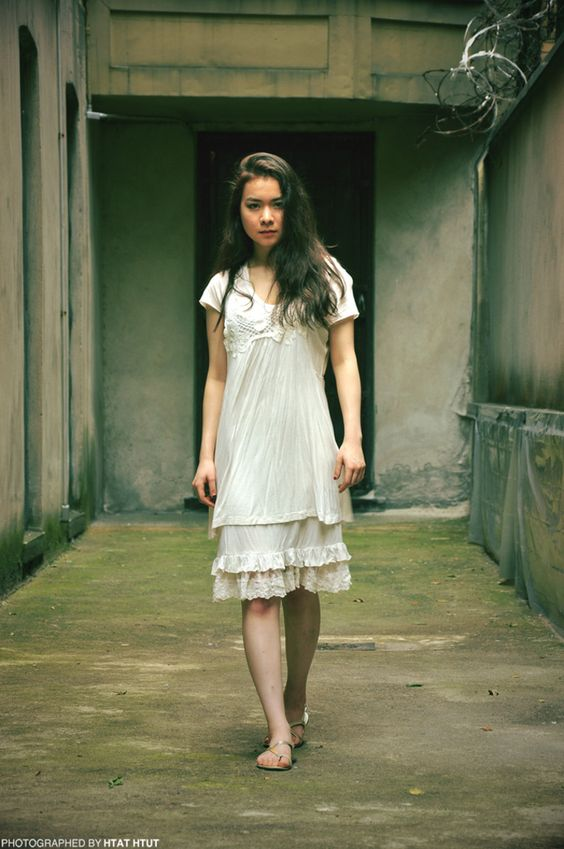 Mitski | Mitski in a white dress standing in a concrete room | Girlfriend is Better