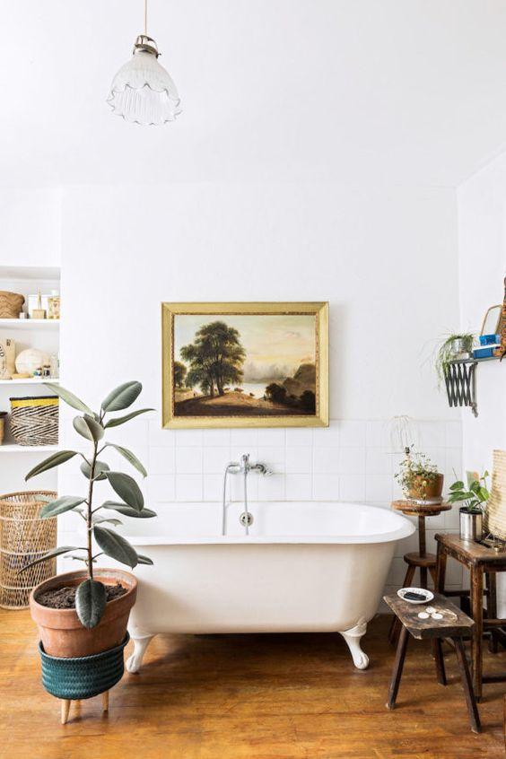 rubber plant | Bohemian decor bathroom claw foot tub terracotta pot | Girlfriend is Better