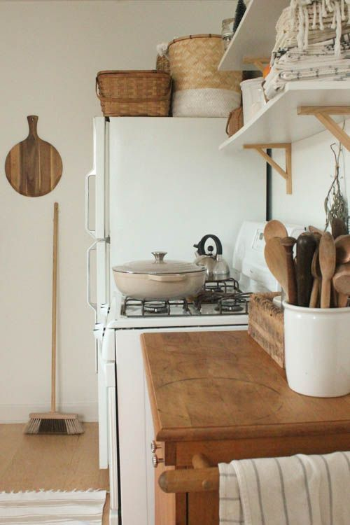 kitchen shelving | wood cabinets organization Spring cleaning baskets containers Hygge | Girlfriend is Better
