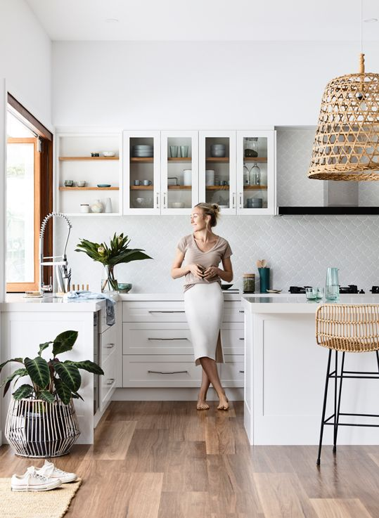 midsummer hygge | white kitchen open shelving rattan hanging light entertaining hostess | Girlfriend is Better